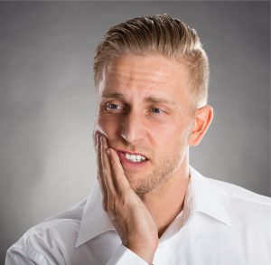 Man with jaw pain who received TMD treatment from a TMJ specialist near Murfreesboro.